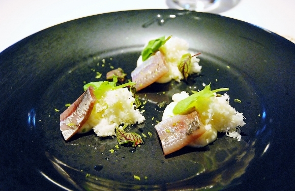 Smoked sardine with variouse textured colidlower and sorrel leaves